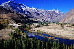 Gilgit River cutting through the cultivated valley with mountains in the background, Phander.~ Pakistan