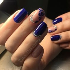 Blue violet rose nail art design. The nails are painted in blue violet as well as the details of the roses are also in blue violet polish against a clear coat as the background.