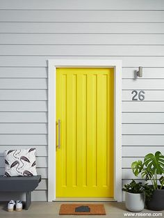 A bright yellow entry door Timber Planks, Timber Deck, Concrete Deck, Door Paint Colors, Exterior Paint Colors, Exterior House Colors, Resene Colours, Large Plant Pots, Weatherboard House
