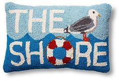 Beachy charm abounds on this hooked wool pillow.