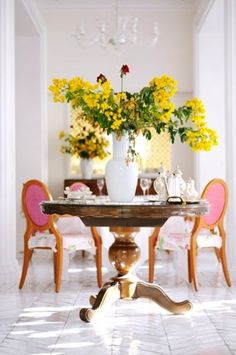 bright, beautiful, and fresh.  love the white chevron floors, and pink upholstered antique chairs