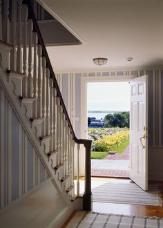 PSD Architects designed major additions and renovations to this historic Shore Road home, winning the Chatham Preservation Award in Coastal Living Rooms, Coastal Homes, Feng Shui Interior Design, Stairs Trim, Beautiful Beach Houses, Carriage House Plans, Beach Cottage Style, Architect Design, Stairways