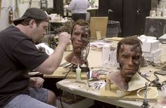 """Trevor L. Hensley adds bloody detail to a couple """"battle-damaged"""" Arnold puppet heads at SWS."""