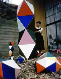"""chicagogeek:    Artist and product designer Ray Eames with """"The Toy"""", which was a bright, interactive and expandable environment for child's play. Manufactured in 1951 and the first of her toys to be produced, it consisted of a box of colored paper panels, wooden dowels and connectors large enough to create different shapes and play in and around.  (Source: Herman Miller)"""