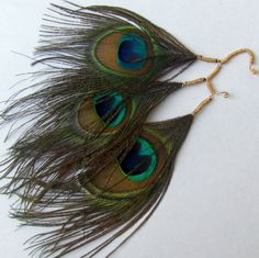 Peacock feather ear cuff on Etsy, $27.00