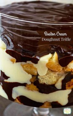 This Boston Cream Donughnut Trifle has layers of fluffy glazed donughts, chocolate ganache, and a wonderful homemade vanilla custard! via @bestblogrecipes