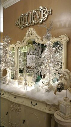 "White white and more white. Love this Christmas/Winter display, and on a dresser! Don't see that often. What I really want though, is the silver ""Believe"" sign on the wall above ... pb†"