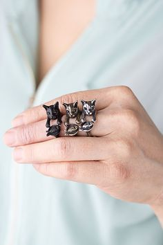 This is cute, but in our house the opposite is true...my cat has me wrapped around HIS finger.YaciKopo+handmade+cat+with+fish+ring+black+/+silver+/+by+yaci,+$70.00