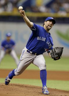Toronto Blue Jays starting pitcher R.A. Dickey delivers to Tampa Bay Rays' David DeJesus during the first inning of a baseball game Monday, March 31, 2014, in St. Petersburg, Fla. (AP Photo/Chris O'Meara)