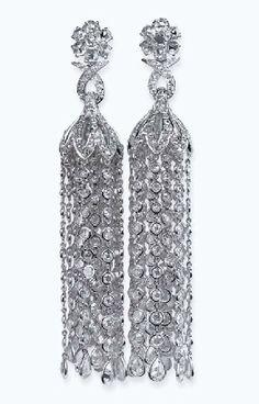 A PAIR OF DIAMOND 'CHANDELIER' EAR PENDANTS   Each designed as a rose-cut diamond floral surmount to the diamond pagoda with rose-cut diamond tassels, mounted in 18k white gold, 11.0 cm long
