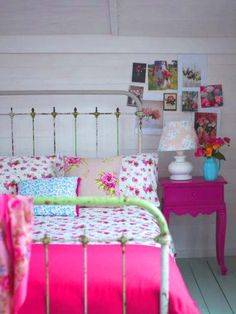 Love the green metal bed frame and pink nightstand..antique great for a guest bedroom