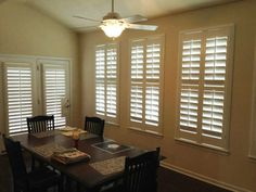 Kitchen With French Door Shutters And Window Shutters.  Shutters by The Louver Shop.