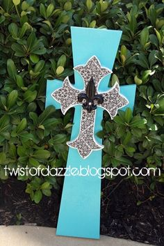 Large Teal and Black Cross topped with a Fleur de lis
