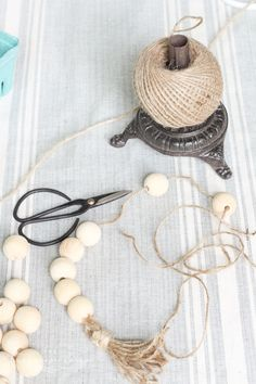 Super cute DIY Wood Bead Garland with Tassels is so easy and fun to make! Cheap, too! Wood Bead Garland, Diy Garland, Beaded Garland, Beaded Chandelier, Garlands, Wooden Diy, Diy Wood, Wood Block Crafts, Wood Projects
