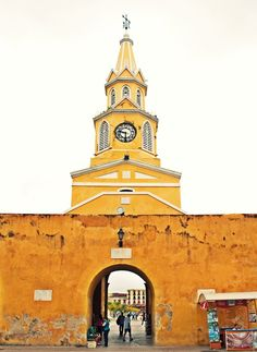 Torre de Reloj, or Clock Tower at the entrance to the walled city of Cartagena, Colombia where my hubby and I commenced our romantic horse and carriage ride through the night-lit cobbled streets of this magical place. Can't you hear the clip-clop of horse's hooves on the smooth polished cobblestones of this historic city?