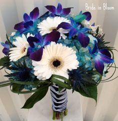 White gerber daisy and blue orchid brides maid boquets (w/ pearl beads, peach ribbon, peach dress)
