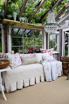 Cozy & colorful sunroom.