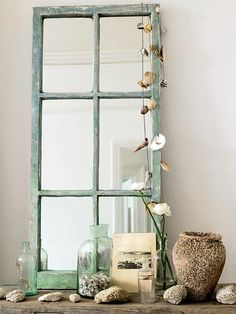 Old window pane with mirrors to replace glass-like the shells hanging on the side