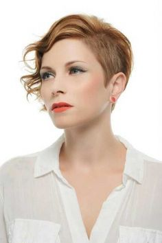 We are seeing so many variations of cool pixies as of late, this short pixie looks amazing with her head unevenly shaved to one side leaving her with a cute layered and waved fringe to the other.