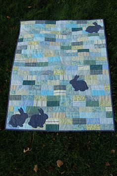 Bricks and Bunnies quilt in blue/green