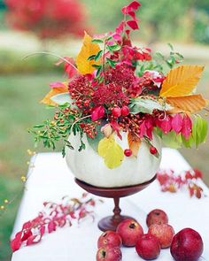 Get in the spirit of today's celebration with a pumpkin centerpiece for your #SaturdaySoiree.