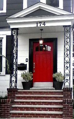 white one story house with black shutters and red door - Google Search
