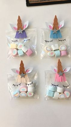 Unicorn Party Favor Bags with multi color marshmallows. How cute are those rainbow treats!