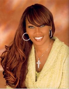Long wavy style for African American women with bangs