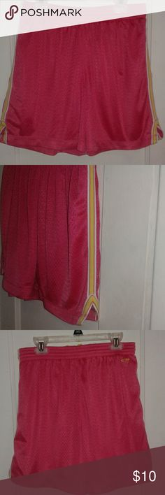 "Champion Basketball Shorts Only worn once!  These comfy mesh pink shorts have an elastic waistband with a yellow drawstring and white and yellow stripes that line each side of the pant leg. Inside lining is pink. Total short length: 16"" Don't like the price? Make an offer! Champion Shorts"