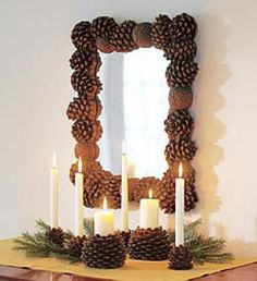 pine cone frame and candle holders with fresh greens...  lovely decor for Christmas through the rest of winter