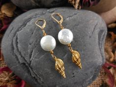 Made with genuine Keshi Pearls, vermeil shell charms, and 14kt gold-filled leverback earring findings.