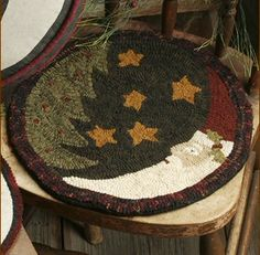 Santa moon hooked rug.  Like him very much! Could be smaller and used as a trivet.                                                                                                                                                      More