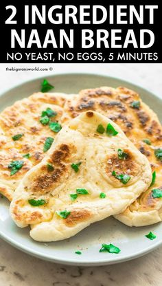 2 Ingredient Dough Naan Recipe- Easy and foolproof homemade naan bread without yeast and without oil- Greek yogurt dough to make a thick, chewy and doughy naan ready in minutes! Naan Bread Recipe Easy, Naan Bread Vegan, Homemade Naan Bread, Recipes With Naan Bread, Dairy Free Naan Bread, Easy Bread, Indian Food Recipes, Vegan Recipes, Cooking Recipes