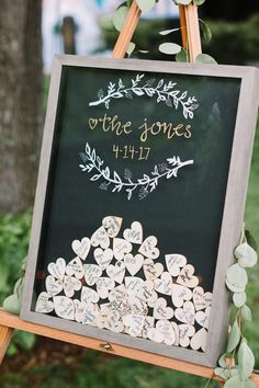 21 Unique Wedding Guest Book Ideas for All Couples Wedding guests were able to slip heart-shaped notes in a personalized shadow box, frame and all, which the couple displayed on an easel with greenery. Wedding Favors And Gifts, Creative Wedding Favors, Inexpensive Wedding Favors, Wedding Keepsakes, Wedding Keepsake Ideas For Guests, Guest Book Ideas For Wedding, Unique Guest Book Ideas, Wedding Guest Favors, Rustic Wedding Guest Book