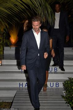 David Beckham suits up for whisky launch in Miami #dailymail