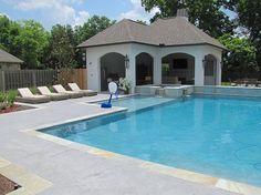 Salt rock texture stamped concrete shapes the cool pool deck [Design: Nu-Crete Designs]