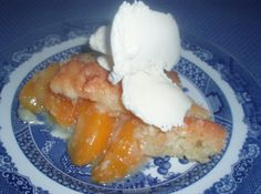 Blue Ribbon Peach Cobbler , Just a pinch recipe :   Comments from the Test Kitchen:  Warm cobbler with ice cream on top?! Hard to beat in my book! One bite of this dessert and I can understand why everyone wants the recipe.  Thanks for sharing with us, Laura!