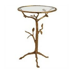 Bring the outdoors in with this unique and beautiful accent table. Each piece is elegantly crafted from iron with a glass top.