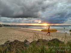 Sunset and a surf board in Coolangatta beach Queensland