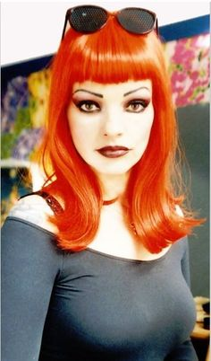 Nina Hagen with bright orange mid-length hair with blunt bangs. I Like Nina Her Outrageousness Nina Hagen, Hairstyles With Bangs, Trendy Hairstyles, Haircuts, Gefärbter Pony, Dyed Bangs, Hair Bangs, Photo Rock, Lancaster