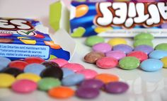 Food fight! Comparing Canadian vs. U.K. Smarties candies. (Not to be confused with American Smarties candies.)