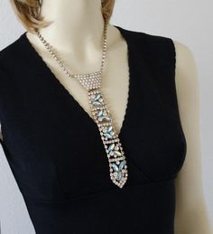 This drippy vintage bib necklace made to look like a tie, is made by DeLizza & Elster, better known for the JULIANA line of jewelry, which this