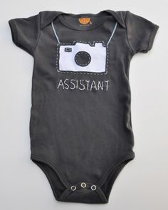 "BESTSELLER! Love Photography? This adorable ""assistant"" shirt is the  perfect gift for a little one. Hand made in Los Angeles, this super soft,  cute shirt is sure to bring smiles. Hand or Machine was cold water.  Customized the way you want it."