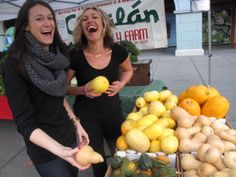 Shannan Slevin and Alicia Cass of Daily Fruition are all smiles while shopping at the farmer's market in San Francisco