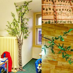 DIY olive tree for primary school classroom reading corner. Olives made of lightweight air-drying clay, wire put in when half-dry. Dipped in acrylic paint and hung to dry. Leaves made of florist's fabric. Branches made of various wire and florist's tape. Trunk made of gardening poles and fabric, acrylic paint used for bark accents. Trunk and branches attached to the wall with nails and wire for safety.