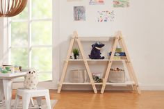Ladder shelf with inter-changable pastel buttons.