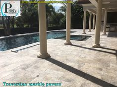 A true outdoor paradise for this pool deck remodel is seen here using beautiful travertine marble pavers along with stylish pool tile.  The many columns just ad to the entire scene.  Give us a call today @ 561-488-5000 and see how we can help you with your outdoor renovation project.  #travertinepavers #pooldeck #pooltile