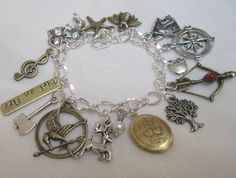 The Hunger Games Charm Bracelet Girl On Fire by HeartsofFaith