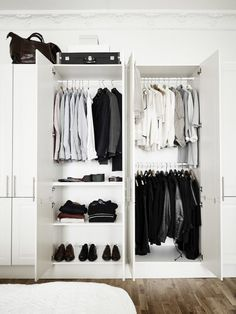 White shelving with doors to create a dressing room