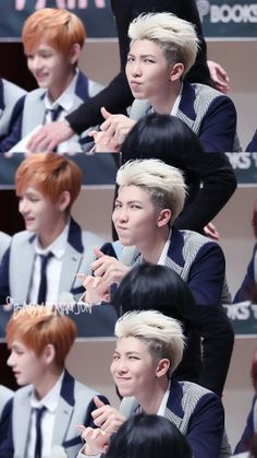 Rapmonster with an awkward V in the backround